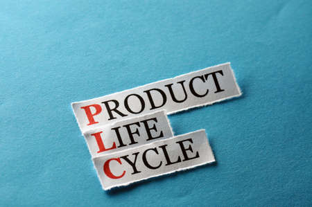 PLC Product Life Cycle, words on cut paper hard light photo