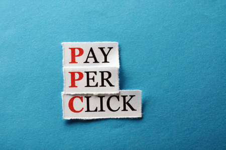 PPC Pay Per Click, words on cut paper hard light