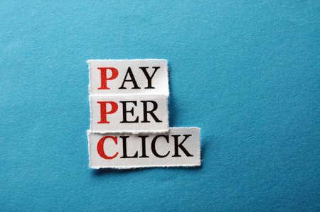 per: PPC Pay Per Click, words on cut paper hard light