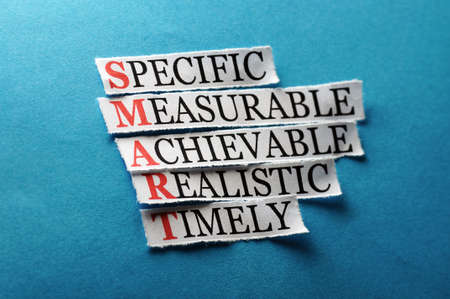 Smart  acronym in business concept, words on cut paper hard light