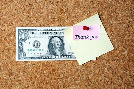 affixed: thank you  memo note  and dollar bill  affixed to the corkboard space for text
