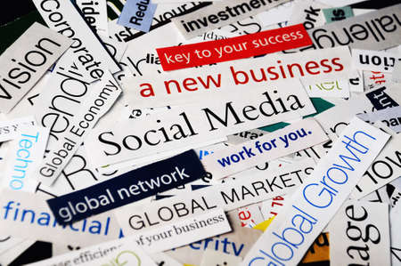 collage of paper headlines about the global   economy and social media business photo