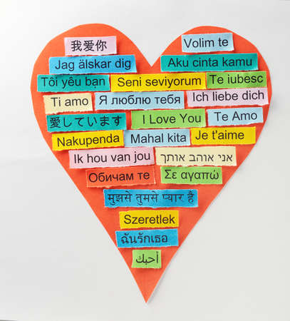 I Love You   Word Cloud printed on colorful paper in different languages on heart shape photo