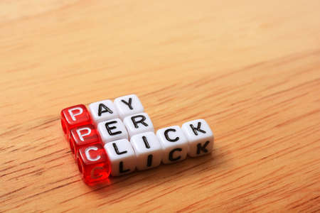 ppc: PPC text , pay per click  cubes on wooden background