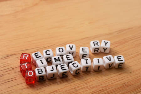 time critical: cubes with text , rto recovery time objective on wood Stock Photo