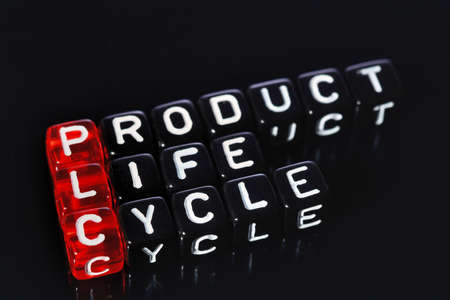 plc: PLC Product Life Cycle, words on red  cubes on black  background