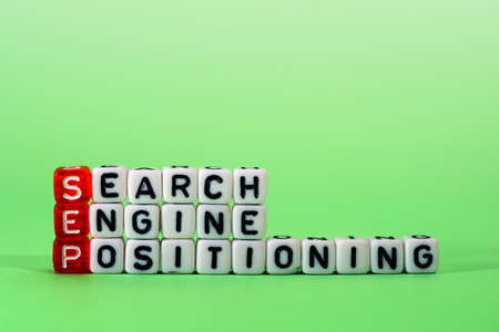 sep: cubes with text ,SEP  Search Engine Positioning  on green background Stock Photo