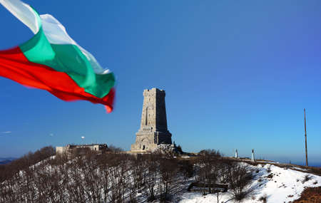 Memorial Shipka view in Bulgaria.Bulgarian flag in front.