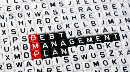 debt management: cubes with text  dmp ,debt management plan Stock Photo