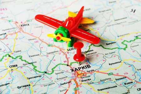 annexation: Close up of  Charkov ,Ukraine , map and airplane toy