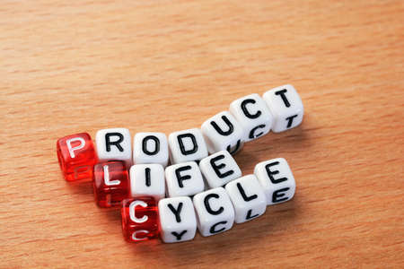 plc: cubes with text PLC ,Product Life Cycle on wood