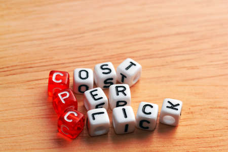 cpc: CPC Cost Per Click written  on dices on wood Stock Photo