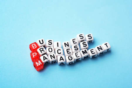 bpm: bpm, business process management on dices on blue background