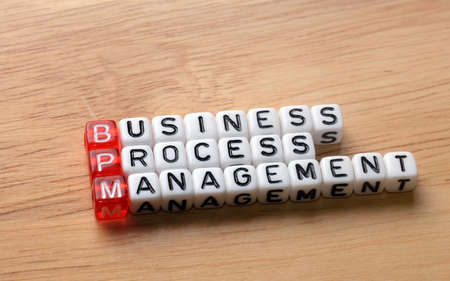 bpm: bpm, business process management on dices on wooden background Stock Photo