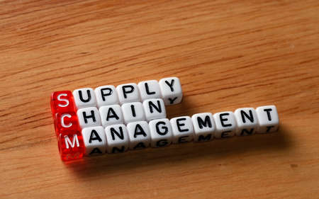 scm: SCM Supply Chain Management written on dices on wooden background