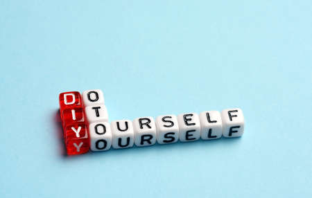 do it yourself: DIY Do It Yourself written on dices on blue background