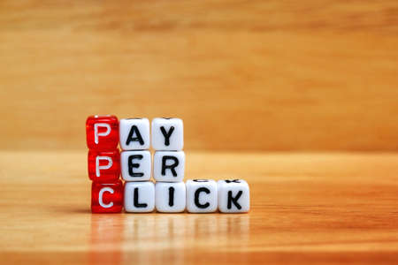 ppc: PPC Pay Per Click text on  dices on wooden background