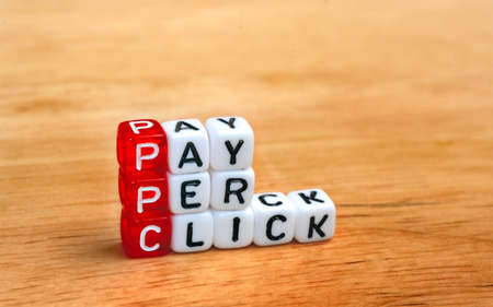 PPC Pay Per Click text on  dices on wooden background 版權商用圖片 - 41977502