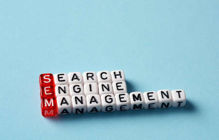 emarketing: SEM Search Engine Management written on black and white  dices Stock Photo
