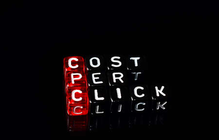 cpc: CPC Cost Per Click writen on black and white  dices