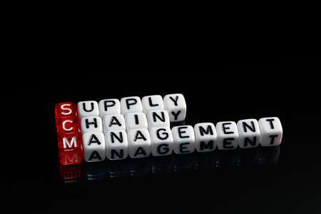 scm: SCM Supply Chain Management written on dices on black background