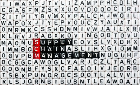 scm: SCM Supply Chain Management written on black and white  dices
