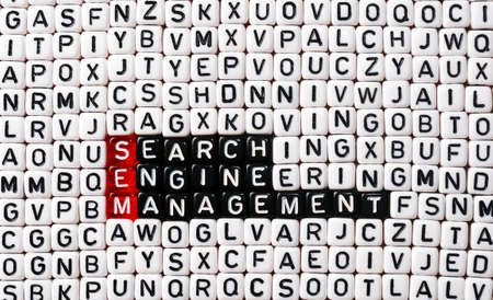 sem: SEM Search Engine Management written on black and white  dices Stock Photo