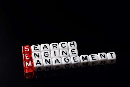 emarketing: SEM Search Engine Management written on   dices  on black