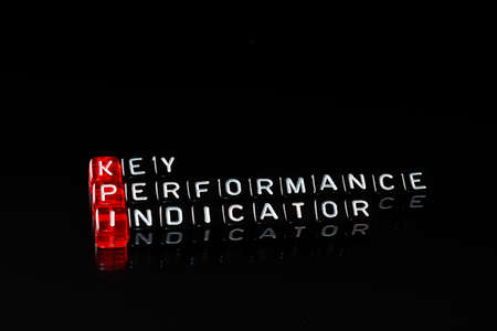 business process: KPI Key Performance Indicator written on dices on black