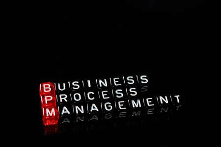 bpm: BPM Business Process Management written on cubes on black Stock Photo