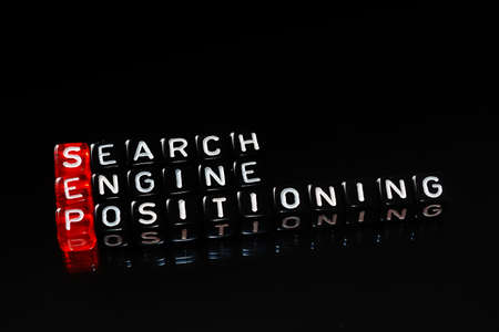 sep: SEP Search Engine Positioning text written  on cubes ob black