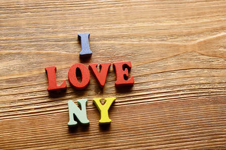 I Love Ny Word Made From Multicolored Letters On Wooden Background Warm Color Stock Photo