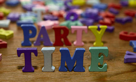 party time: party time  - words  made from multicolored   letters on wooden  background