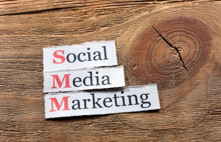 smm: SMM - Social Media Marketing on paper ,wooden background Stock Photo