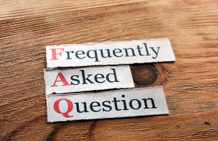 frequently asked question: frequently asked question (FAQ) concept for website service on wood Stock Photo