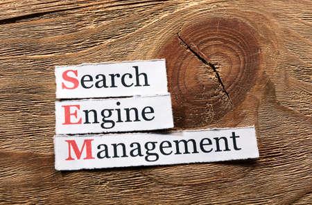 sem: acronym SEM - Search Engine Management  on paper on wood