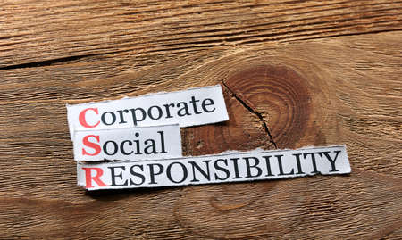 responsibility: Corporate social responsibility (CSR) concept on paper on wood
