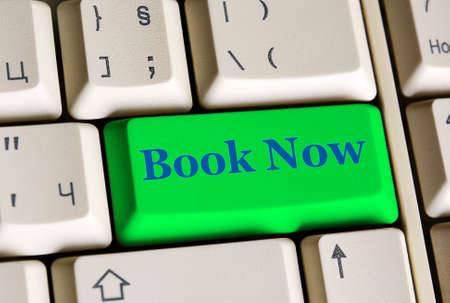 e ticket: Book Now   on computer keyboard -  online booking concept