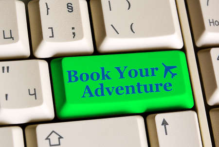 e ticket: Book Your Adventure   on computer keyboard -  online booking concept Stock Photo