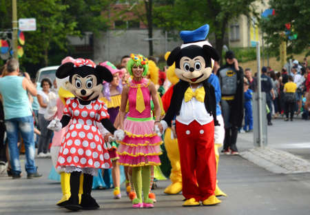 mickey: GABROVO  BULGARIA - MAY 16 2015 : Mickey Mouse, Minnie Mouse at the yearly carnaval in Gabrovo city