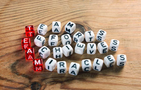 acronym of  TEAM  red and  dices on wood Stock Photo