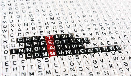 acronym: acronym of  TEAM  red and  dices on wood Stock Photo