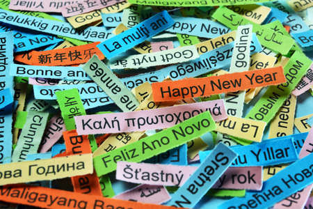 Happy New Year  Word Cloud printed on colorful paper different languages Stock Photo
