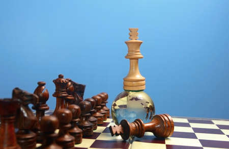white chess king on glass globe . Winner or success  concept.