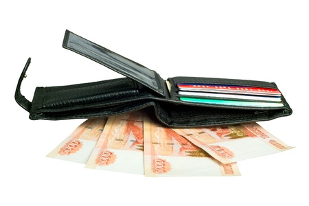 black wallet with russian rubles and plastic cards on a white background