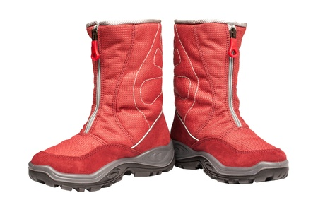 two children s red waterproof boots on a white background Stock Photo