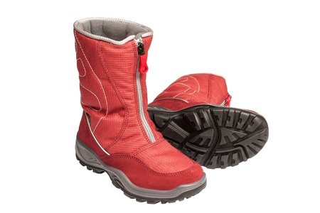 waterproof: two children s red waterproof boots on a white background Stock Photo