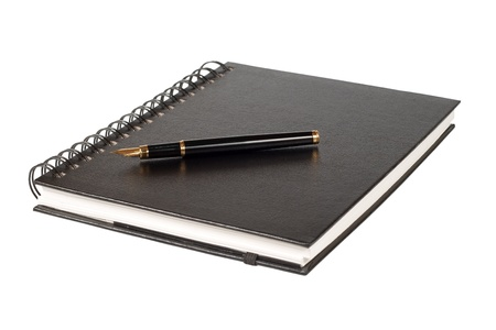 black notebook and the black pen with a gold feather