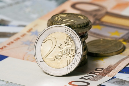 The European currency  banknotes of five and fifty euros and coins