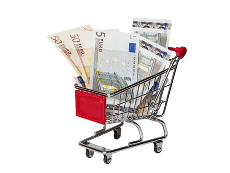 Shopping cart with banknotes of 5 and 50 euro on a white background